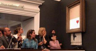 اثر هنری Banksy لحظاتی پس از فروش ۱.۴ میلیون دلاری در مزایده، خود را از بین برد!